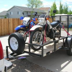 How do you tie down two motorcycles on a trailer?