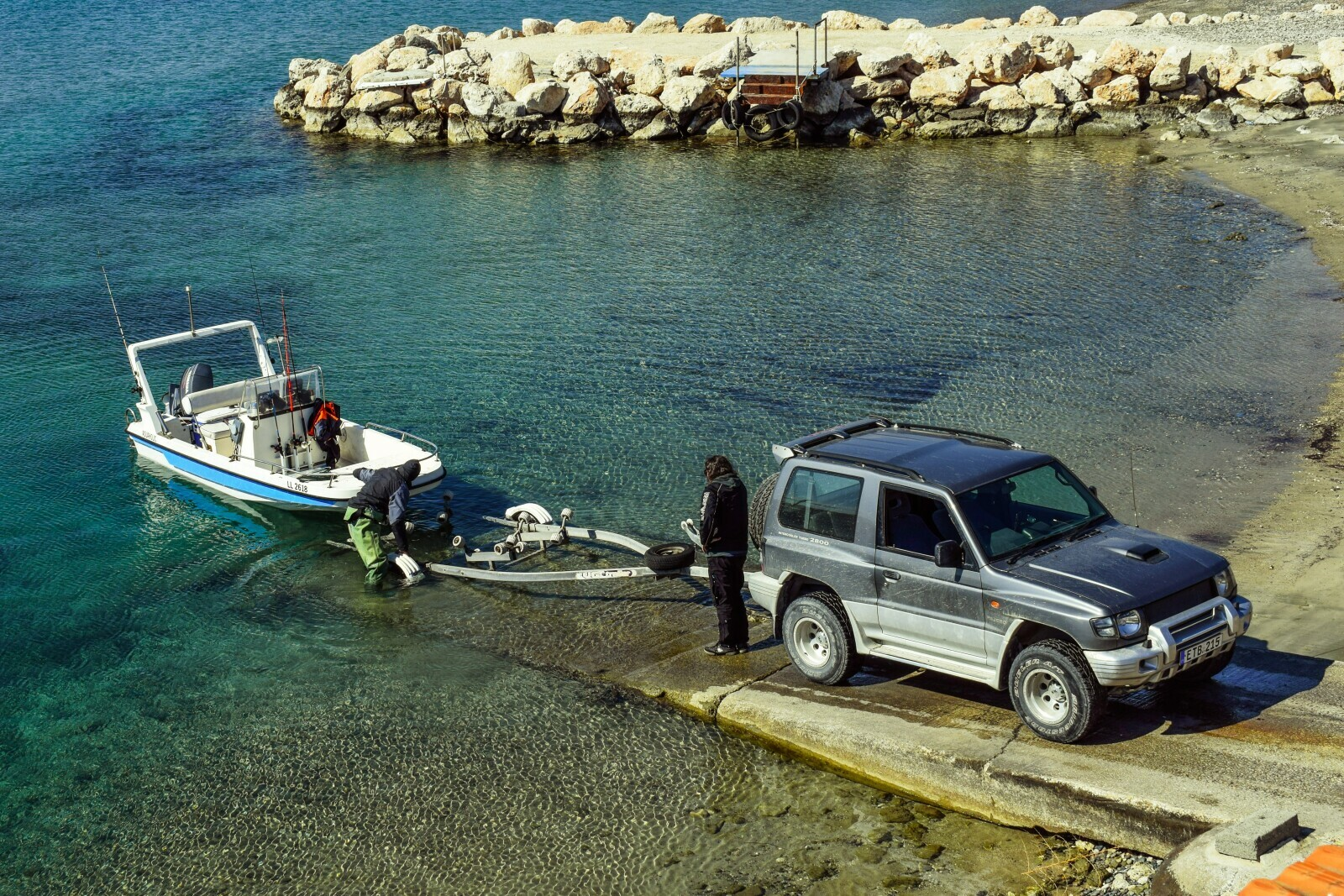Jeep towing boat on a trailer