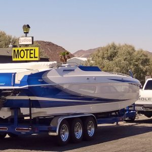 Boat on a trailer towed by a pickup truck
