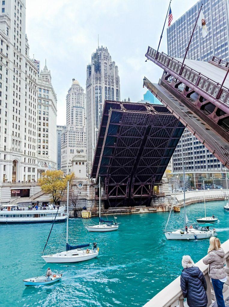 Boats sailing under a bridge