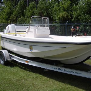 A white boat on a trailer