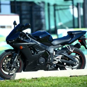 Black Sportbike Parked on the Street. Fast Sporty Looking Motorcycle.